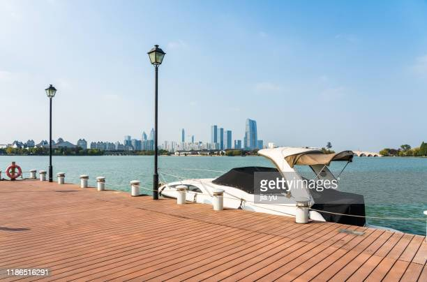 tourboats moored at wharf - jetty stock pictures, royalty-free photos & images