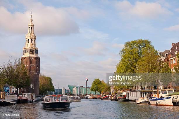 tourboats passing the oude schans - merten snijders stock-fotos und bilder