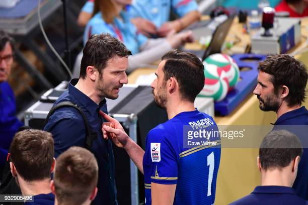 Tourcoing coach Igor Juricic and Nuno Pinheiro of Paris exchange words at the end of the second set as Paris Volley coach Dorian Rougeyron looks on...