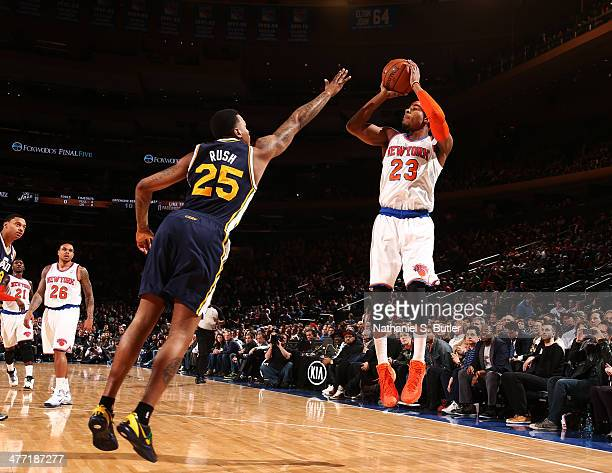 Toure' Murry of the New York Knicks shoots against Brandon Rush of the Utah Jazz during a game at Madison Square Garden in New York City on March 7...