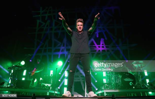 Touring guitarist Anthony Esperance singer Jacoby Shaddix and drummer Tony Palermo of Papa Roach perform during a stop of the 15 Years in the Making...