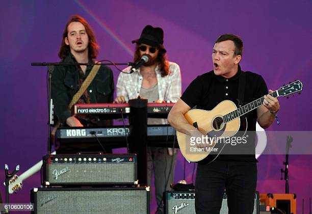 Touring guitarist Nick Bockrath touring keyboardist/guitarist Matthan Minster and guitarist Brad Shultz of Cage the Elephant perform during the 2016...