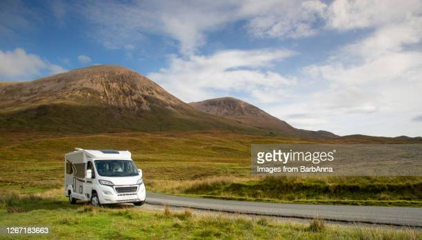 touring in a motorhome - skye, scotland, uk - camper van stock pictures, royalty-free photos & images