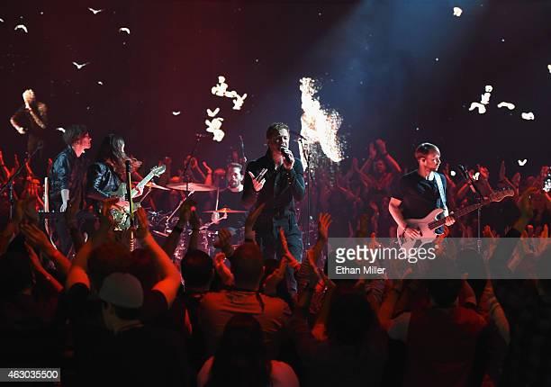Touring member Ryan Walker guitarist Wayne Sermon drummer Daniel Platzman singer/drummer Dan Reynolds and bassist Ben McKee of Imagine Dragons...