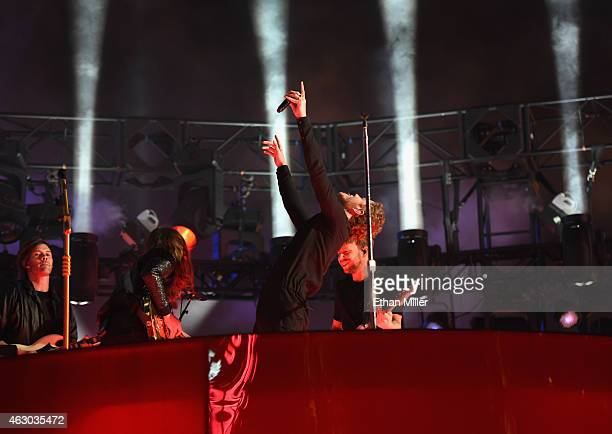 Touring member Ryan Walker guitarist Wayne Sermon singer/drummer Dan Reynolds and bassist Ben McKee of Imagine Dragons perform live for a Target...