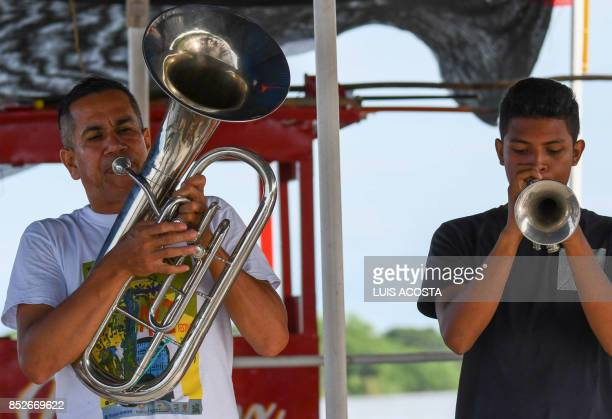 Touring musicians play their instruments in Santa Cruz de Mompox Department of Bolivar September 23 2017 the Colombian town on the banks of the great...