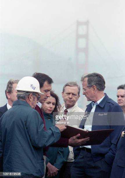 Touring the earthquake area President George Bush has the Golden Gate Bridge as a backdrop while being briefed by San Francisco Mayor Art Agnos...