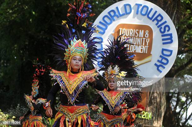 Tourism activists wearing traditional puppet costumes dance during a festival held to celebrate the World Tourism Day in Surakarta Central Java...