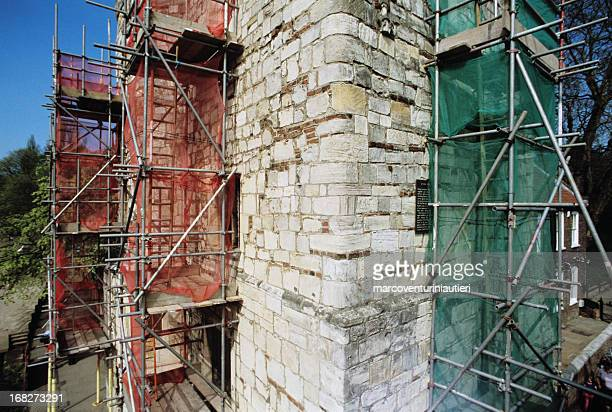 tourism and construction works: lendal tower during restoration - marcoventuriniautieri stock pictures, royalty-free photos & images