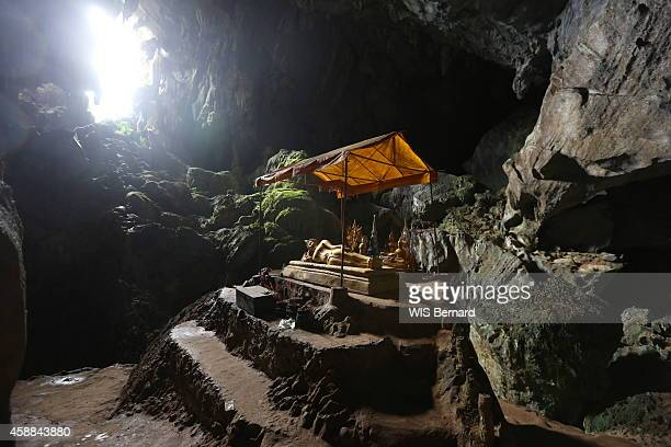 Tourism in Laos in the town of Vang Vieng looking like the Halong bay near the river Nam Song the golden Buddha lying in the cave Tham Poukham