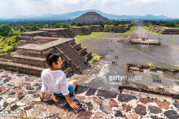tourism in mexico - young adult tourist at ancient pyramids - pyramid stock pictures, royalty-free photos & images