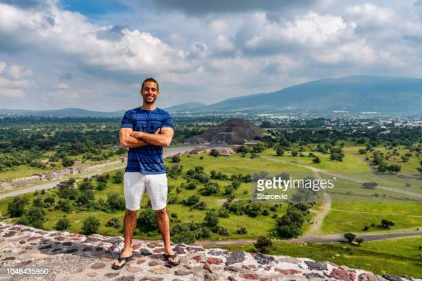 Tourism in Mexico - young adult tourist visits ancient pyramids