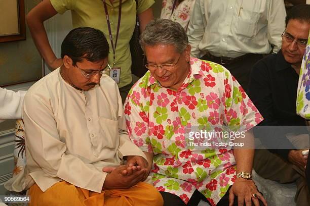 Tourism Minister of Malaysia Datuk Seri Tengku Adnan Tengku Mansur showing his palm to a palmist during
