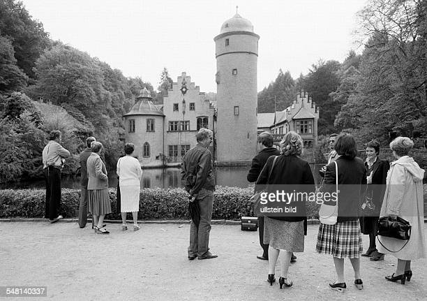 tourism people at the Castle Mespelbrunn moated castle renaissance DMespelbrunn Spessart nature reserve Bavarian Spessart Franconia Bavaria