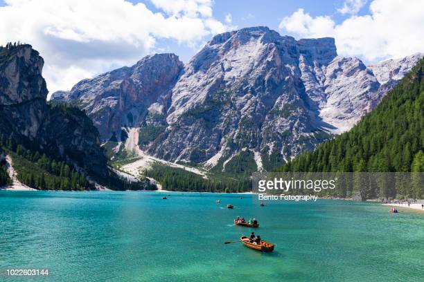 tourism sailing boat in lake braies, dolomite, italy. - pragser wildsee stock pictures, royalty-free photos & images