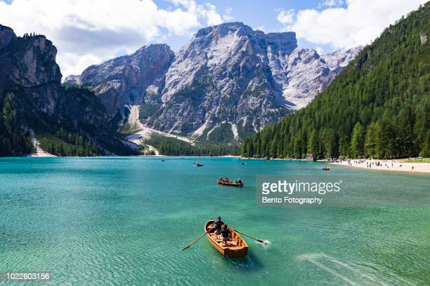 tourism sailing boat in lake braies, dolomite, italy. - dolomites stock pictures, royalty-free photos & images