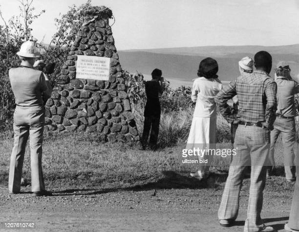 Tourists in front of the tombstone for Michael Grzimek on the top of the Ngorongoro Crater in Tanzania