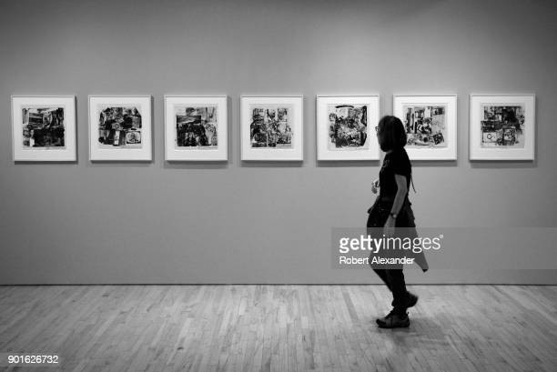 A tourist admires prints by artist Robert Rauschenberg at Gemini GEL gallery in the Chelsea district of New York City