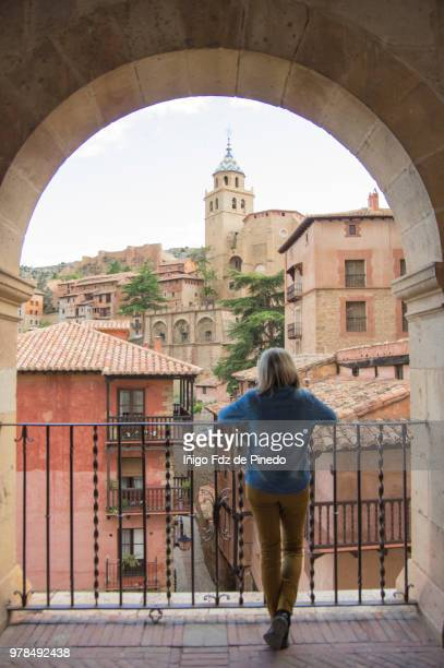 a tourist admires the view of albarracin - teruel province - aragon - spain. - nook architecture stock pictures, royalty-free photos & images