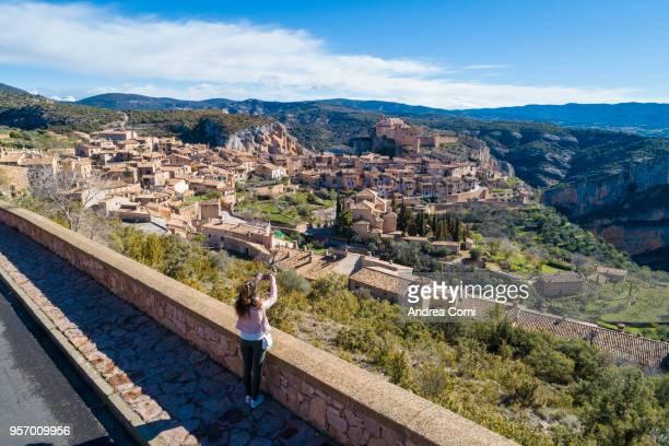 A tourist admires the view of Alquezar village. Alquezar, Huesca, Aragon, Spain