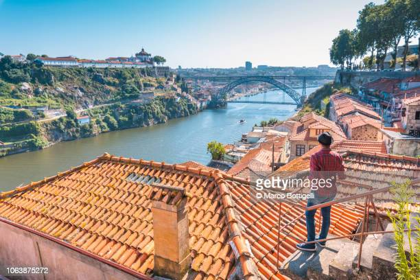 Tourist admiring Porto and Dom Luis I bridge
