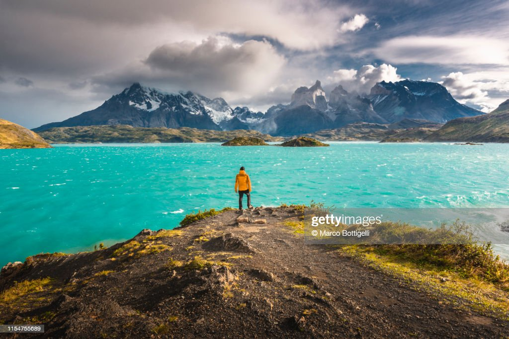 Tourist admiring the Cordillera Paine in Torres del Paine National Park, Chile : Stock Photo