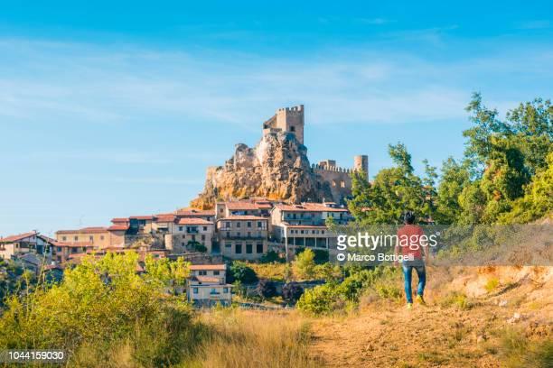 tourist admiring the medieval town of frias (burgos), spain - カスティーリャレオン ストックフォトと画像