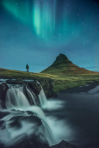 Tourist admiring the Northern lights, Iceland - gettyimageskorea