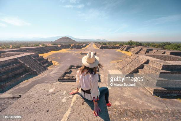 tourist admiring the teotihuacan archaelogical site, state of mexico - mexico stock pictures, royalty-free photos & images