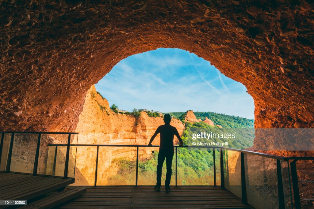 Tourist admiring the view from a lookout of a cave in Las Medulas, Spain. : Stock Photo