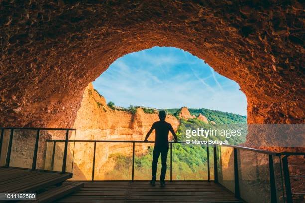 Tourist admiring the view from a lookout of a cave in Las Medulas, Spain.