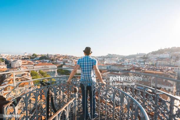 Tourist admiring the view from the Elevador de Santa Justa, Lisbon