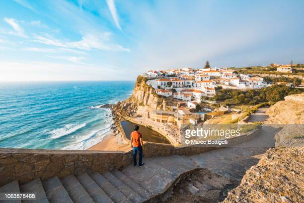 tourist admiring the view in azenhas do mar, lisbon - portugal stock pictures, royalty-free photos & images