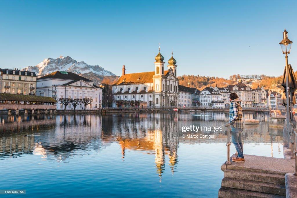 Tourist admiring the view in Lucerne, Switzerland : Foto de stock