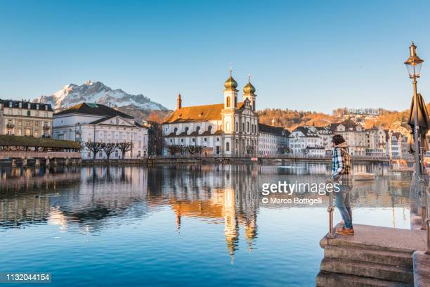 tourist admiring the view in lucerne, switzerland - switzerland stock pictures, royalty-free photos & images