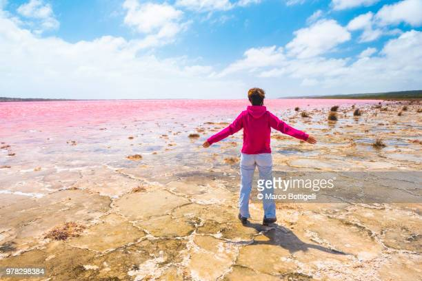 Tourist amazed by the view of the pink Hutt Lagoon, Western Australia.