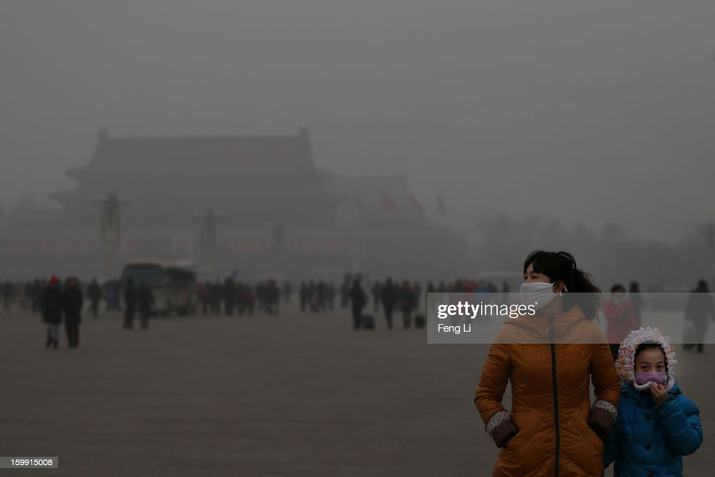 A tourist and her daughter wearing the masks visit the Tiananmen Square at dangerous levels of air pollution on January 23, 2013 in Beijing, China. The air quality in Beijing on Wednesday hit serious levels again, as smog blanketed the city.
