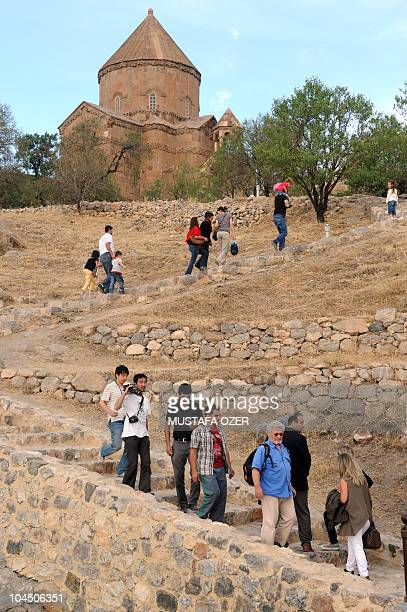 Tourist and locals visit the Holy Cross church on Akhtamar Island in Van eastern Turkey on September 18 2010 The first liturgy in 95 years is...