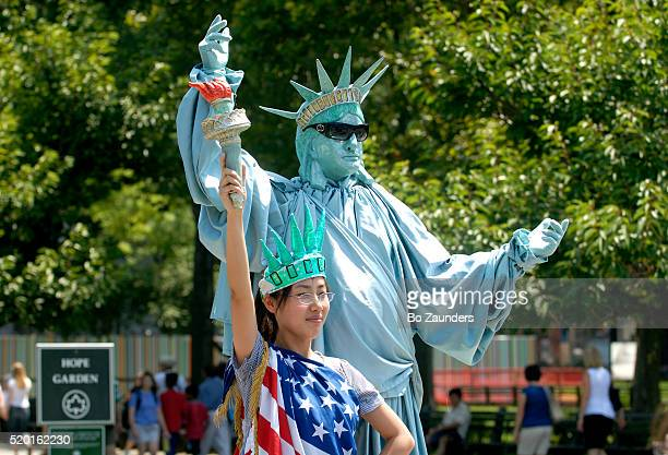 Tourist and Mime as Statue of Liberty
