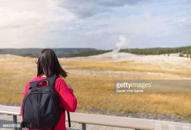 Tourist and old faithful, Yellowstone