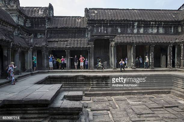 Tourist and visitors explore within Angkor Wat Siem Reap Cambodia Angkor Wat is Cambodias main tourist destination and one of UNESCOs world heritage...