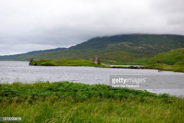 Tourist at Ardvreck Castle, Sutherland County in Highland region, Scotland