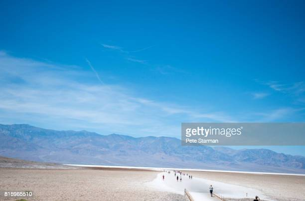 Tourist at Badwater Basin, Death Valley National Park, California.