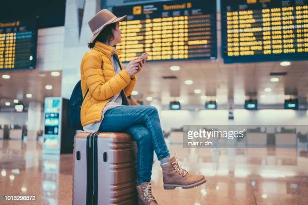 Tourist at Barcelona airport checking the arrival departure board