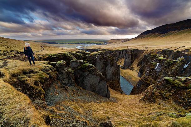 Tourist At Fjadrargljufur Canyon, Iceland Wall Art