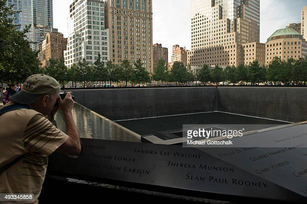 A tourist at Ground Zero memorial on September 26 2015 in New York United States