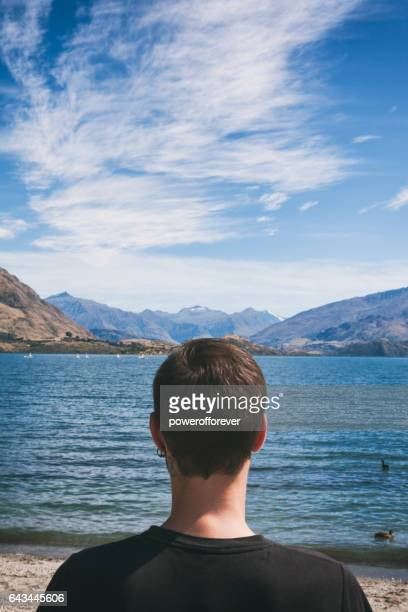Tourist at Lake Wanaka in the Southern Alps of New Zealand