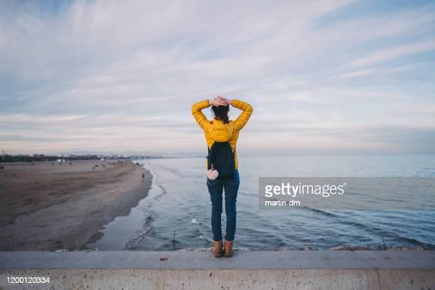 tourist at malvarrosa beach,valencia - wonderlust stock pictures, royalty-free photos & images