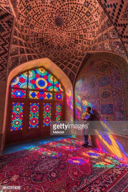 tourist at nasir al-mulk, the pink, mosque, shiraz, iran - shiraz stock pictures, royalty-free photos & images