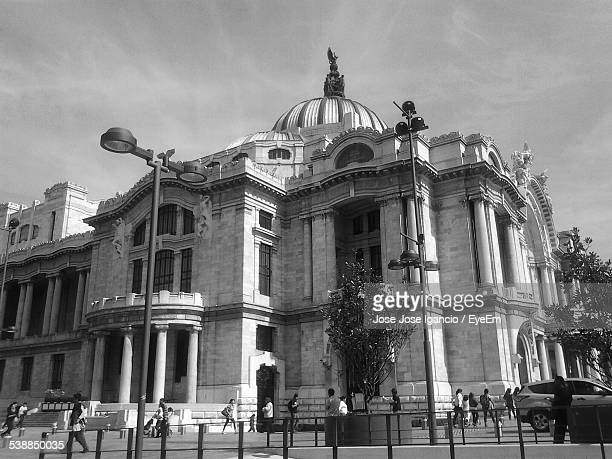 tourist at palacio de bellas artes against sky - mexico black and white stock pictures, royalty-free photos & images